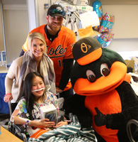 Chris and Jill Davis with CHP patient and Oriole Bird