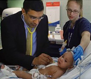 Dr. Kaushal with pediatric patient